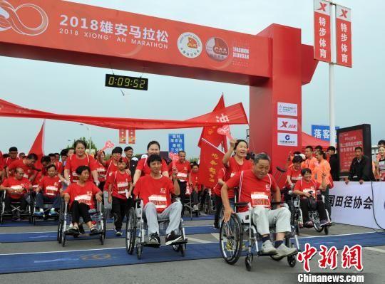 """百位残障选手参与""""梦想1公里""""活动。 韩冰 摄"""