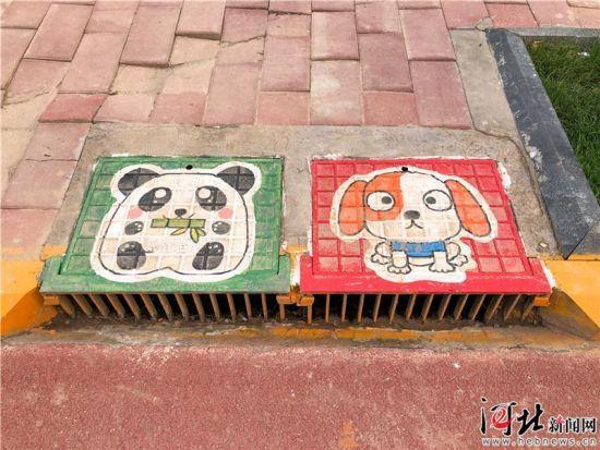 灵寿县井盖彩绘为旅发大会添彩 摄影 杜船